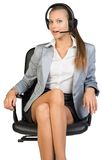 Businesswoman in headset sitting on office chair Royalty Free Stock Image
