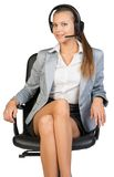Businesswoman in headset sitting on office chair Royalty Free Stock Photos