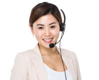 Businesswoman with headset for supporting servies Stock Photography