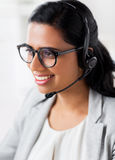 Businesswoman with headset talking at office Royalty Free Stock Photo