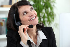 Businesswoman with a headset Royalty Free Stock Images