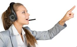 Businesswoman in headset touching or pressing Stock Photography
