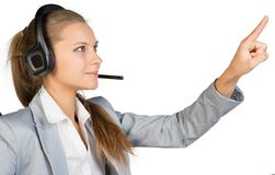 Businesswoman in headset touching or pressing Stock Photo