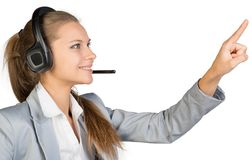 Businesswoman in headset touching or pressing Stock Images