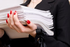 Businesswoman with heap of papers closeup Royalty Free Stock Photography