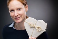 Businesswoman with Heart Shaped Gift Royalty Free Stock Photo