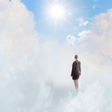 Businesswoman in heaven Stock Photography