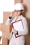 Businesswoman in helmet correcting glasses with cl Royalty Free Stock Image