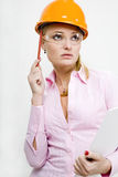 Businesswoman in helmet holding documents. Businesswoman in yellow helmet holding documents Royalty Free Stock Images