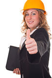 Businesswoman with helmet holding thumb up Stock Image