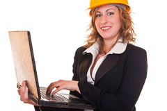 Businesswoman with helmet and laptop Royalty Free Stock Photo
