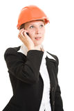 Businesswoman in a helmet with a mobile phone. Royalty Free Stock Photo