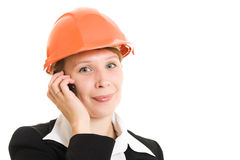 Businesswoman in a helmet with a mobile phone. Stock Photography