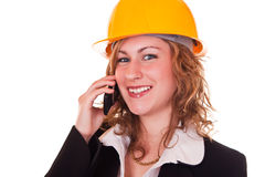 Businesswoman with helmet and phone Royalty Free Stock Photo