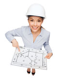 Businesswoman in helmet showing with blueprint Stock Photography