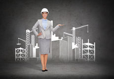 Businesswoman in helmet showing construction site Royalty Free Stock Photography