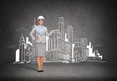 Businesswoman in helmet showing town drawing Stock Image