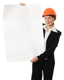 Businesswoman in a helmet shows the blank page. Stock Photography
