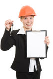 Businesswoman in a helmet shows the blank page. Royalty Free Stock Image