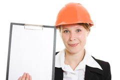 Businesswoman in a helmet shows the blank page. Royalty Free Stock Photography