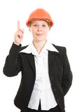 Businesswoman in a helmet shows a finger up. Royalty Free Stock Images