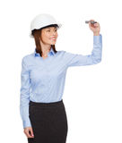 Businesswoman in helmet writing on virtual screen Stock Images