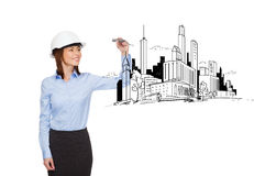 Businesswoman in helmet writing on virtual screen Royalty Free Stock Image