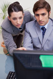 Businesswoman helping her colleague with computer problems Stock Images