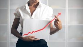 Businesswoman helps statistics royalty free stock photo