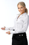 Businesswoman with her arm out. In a welcoming gesture, isolated on white background Royalty Free Stock Images