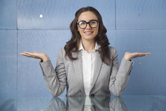 Businesswoman with her arms outstretched. Confident young businesswoman welcome gesture Stock Photos