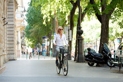 Businesswoman with her bicycle Stock Photography