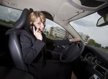 Businesswoman in her car Royalty Free Stock Images