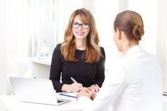 Businesswoman with her client at bank Royalty Free Stock Images