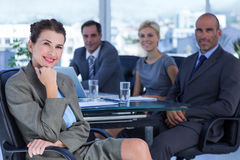 Businesswoman with her colleagues behind Stock Images