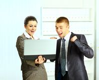 Businesswoman with her colleagues using laptop Stock Photo