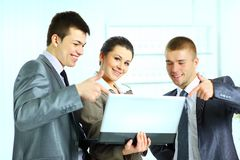 Businesswoman with her colleagues using laptop Stock Images