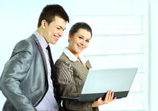 Businesswoman with her colleagues using laptop Royalty Free Stock Image