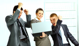 Businesswoman with her collegues using laptop Royalty Free Stock Photos