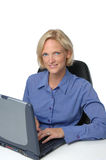 Businesswoman at her desk an c Stock Image