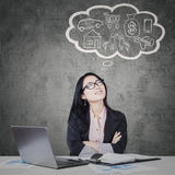 Businesswoman with her dream on a bubble cloud Stock Photo