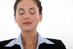 Businesswoman with her eyes closed Stock Photos