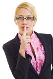 Businesswoman with her finger on her lips Stock Photo