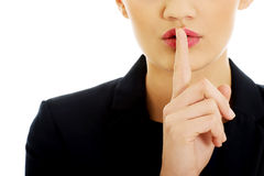 Businesswoman with her finger on lips. Royalty Free Stock Photography