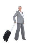 Businesswoman with her luggage Royalty Free Stock Image