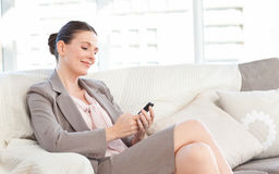 Businesswoman with her mobile Royalty Free Stock Photo