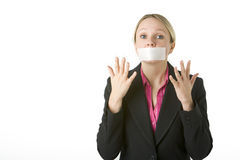 Businesswoman With Her Mouth Taped Shut Royalty Free Stock Images