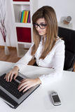 Businesswoman at her office Stock Images