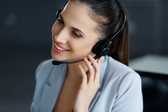 Businesswoman in her office. Call-centre operator Royalty Free Stock Image