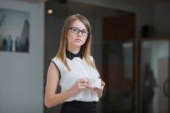 Businesswoman is in her office with a Cup of hot coffee Stock Photography